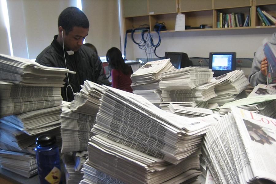 Students prepare to distribute their school newspaper.
